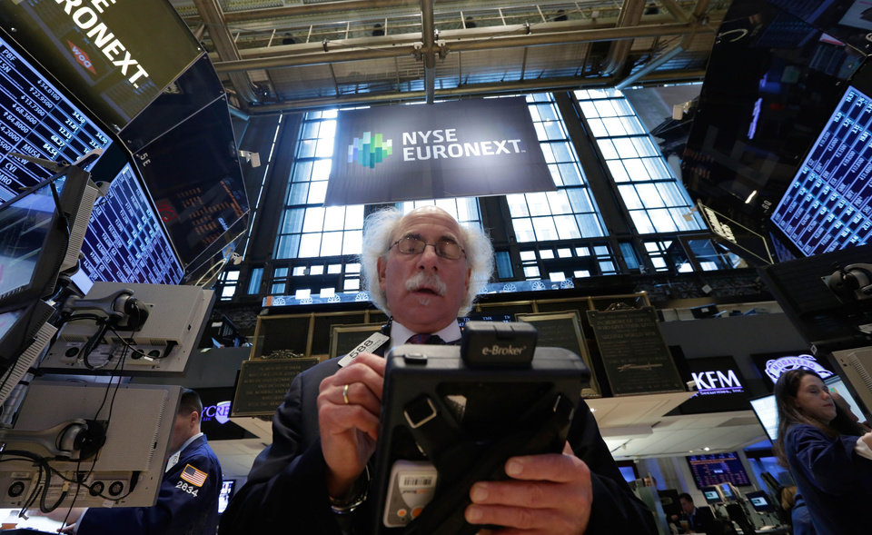 Photo - Trader Peter Tuchman works on the floor of the New York Stock Exchange Wednesday, April 10, 2013. Stocks are opening higher on Wall Street, a day after the Dow Jones industrial average closed at its second all-time high in a week. (AP Photo/Richard Drew)