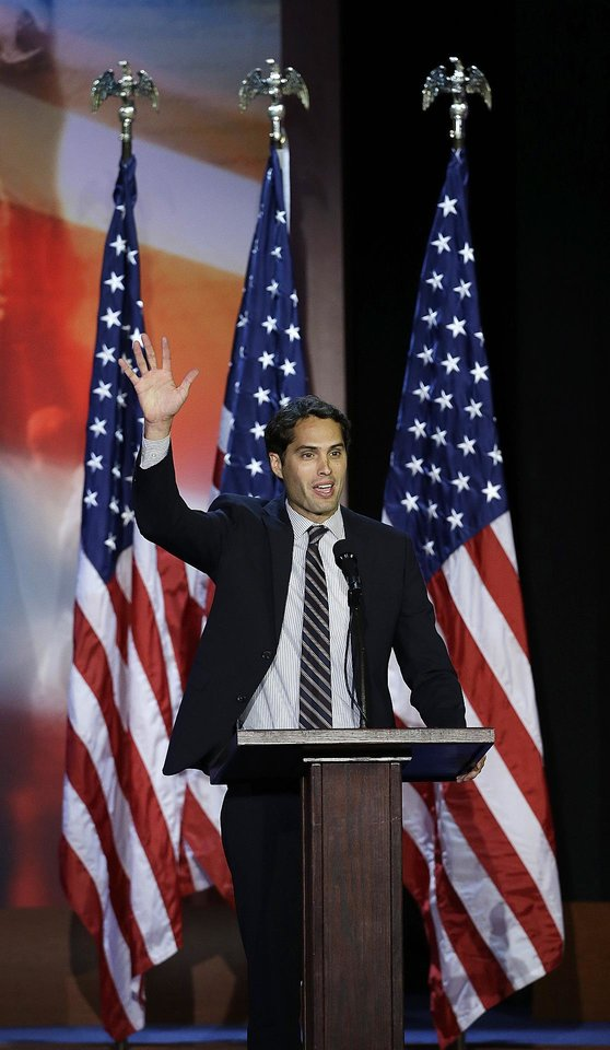 Craig Romney son of Republican presidential candidate and former Massachusetts Gov. Mitt Romney speaks during Mitt's election night rally, Tuesday, Nov. 6, 2012, in Boston. (AP Photo/Elise Amendola)