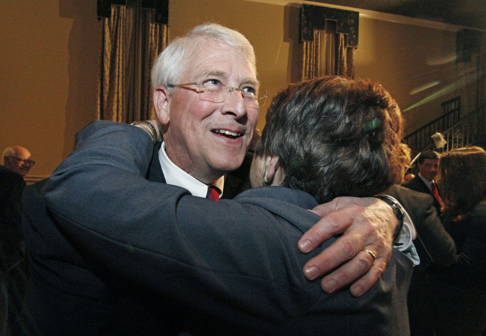 U.S. Sen. Roger Wicker, R-Miss., is greeted by a supporter following his victory speech in Jackson, Miss., Tuesday, Nov. 6, 2012. Wicker was reelected to a full term having defeated Democratic candidate Al Gore Jr., and two independents. (AP Photo/Rogelio V. Solis)