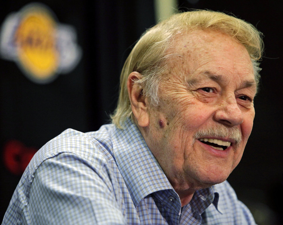 FILE - In this Aug. 17, 2010, file photo, Los Angeles Lakers owner Jerry Buss smiles during an NBA basketball news conference in Bell Gardens, Calif. Buss, the Lakers\' playboy owner who shepherded the NBA franchise to 10 championships, has died in Los Angeles. He was 79. (AP Photo/Damian Dovarganes, File)