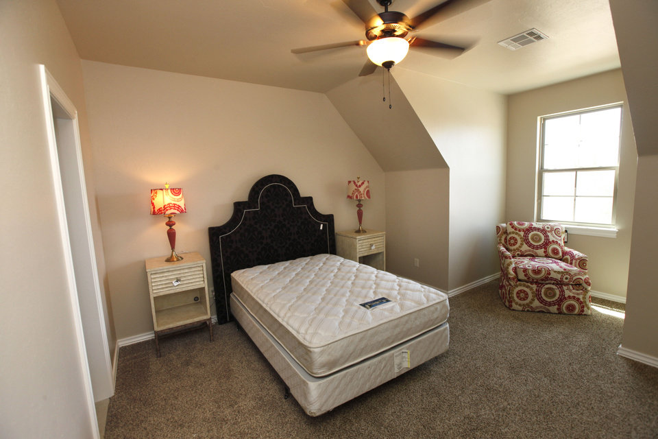 Photo - A secondary bedroom at 3116 Lavender Lane in the Fallbrook addition in Edmond, an entry by Alder Fine Homes in the Parade of Homes Spring Festival.  PAUL HELLSTERN -  Oklahoman