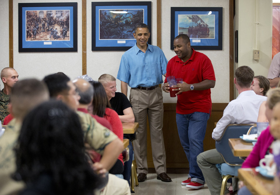 Photo - President Barack Obama visits with members of the military and their families in Anderson Hall at Marine Corp Base Hawaii, Tuesday, Dec. 25, 2012, in Kaneohe Bay, Hawaii. The first family is in Hawaii for a holiday vacation. (AP Photo/Carolyn Kaster)