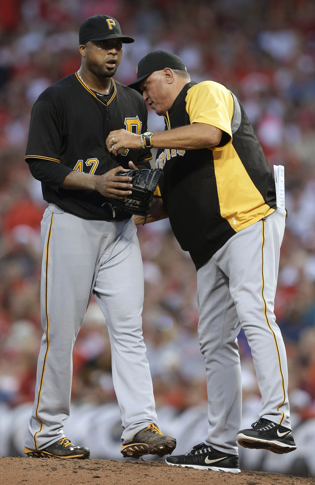 Photo - Pittsburgh Pirates manager Clint Hurdle takes starting pitcher Francisco Liriano out in the fifth inning of a baseball game against the Cincinnati Reds, Friday, July 19, 2013, in Cincinnati. Liriano was charged with five runs in four and one-third innings. (AP Photo/Al Behrman)