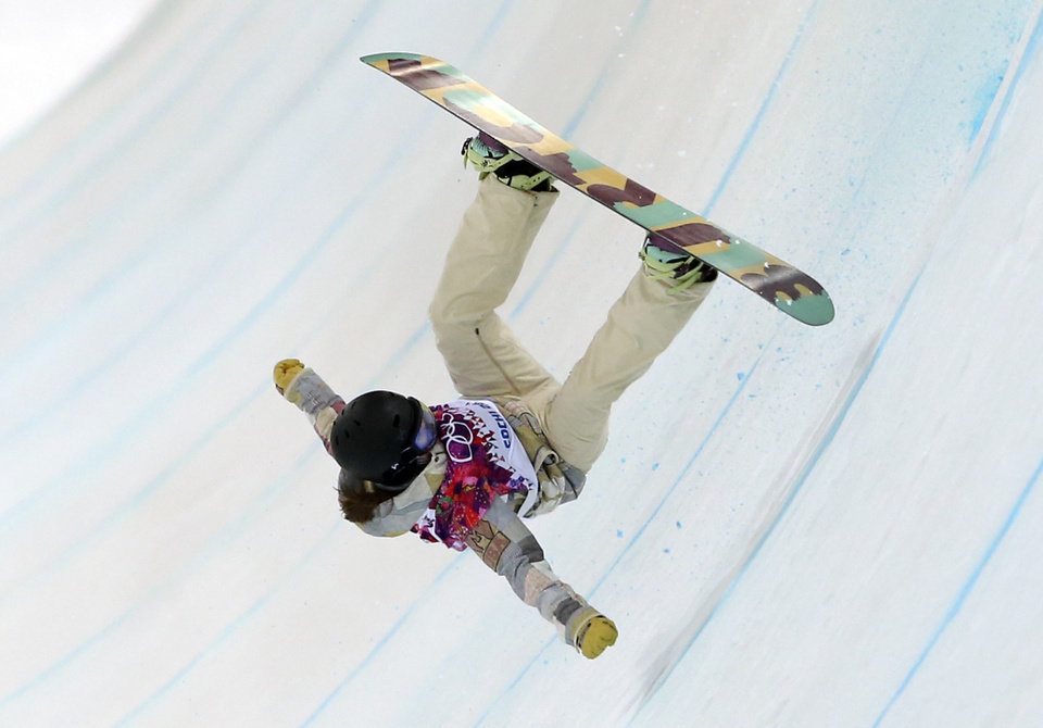 Photo - Kelly Clark of the United States falls in her first run during the women's snowboard halfpipe final at the Rosa Khutor Extreme Park, at the 2014 Winter Olympics, Wednesday, Feb. 12, 2014, in Krasnaya Polyana, Russia. (AP Photo/Sergei Grits)
