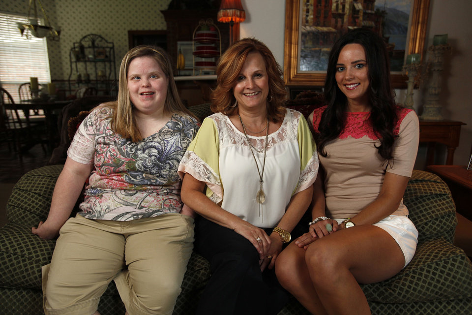 Photo - Lisa Hancock, center, poses for a photo with her daughters, Heather (left) and Jennifer at their house in Oklahoma City, Tuesday, June 5, 2012.  Photo by Garett Fisbeck, The Oklahoman