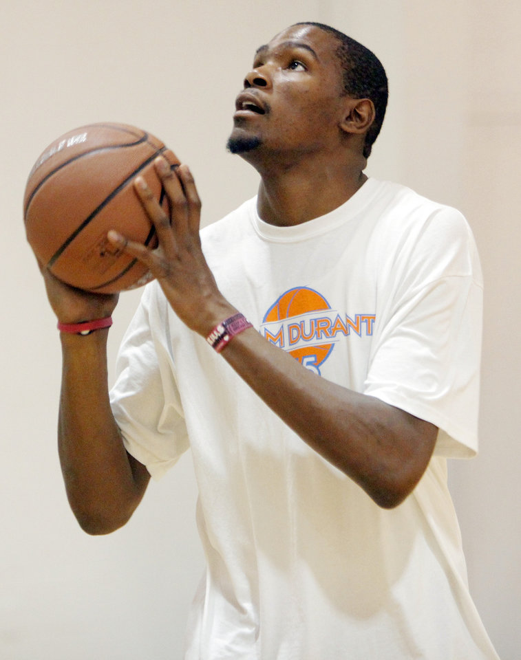 Photo - Kevin Durant takes a shot during Kevin Durant Basketball Camp on Thursday, July 1, 2010, at Heritage Hall School in Oklahoma City. Photo by Nate Billings, The Oklahoman.