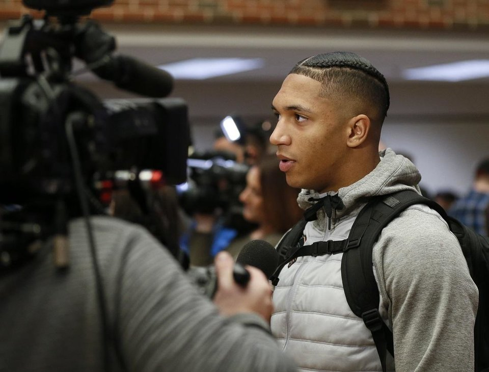 Photo - OSU running back Chuba Hubbard speaks to the media after an OSU football pep rally in the Student Union at Oklahoma State University in Stillwater, Okla., Tuesday, Jan. 21, 2020. [The Oklahoman Archives]