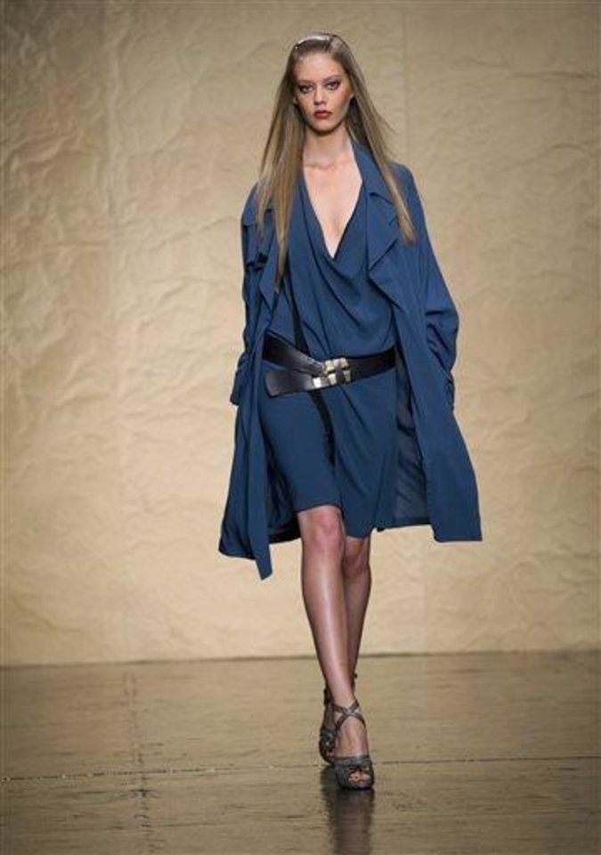 Photo -  The Donna Karan Spring 2014 collection is modeled during Fashion Week in New York, Monday, Sept. 9, 2013. (AP Photo/Craig Ruttle)