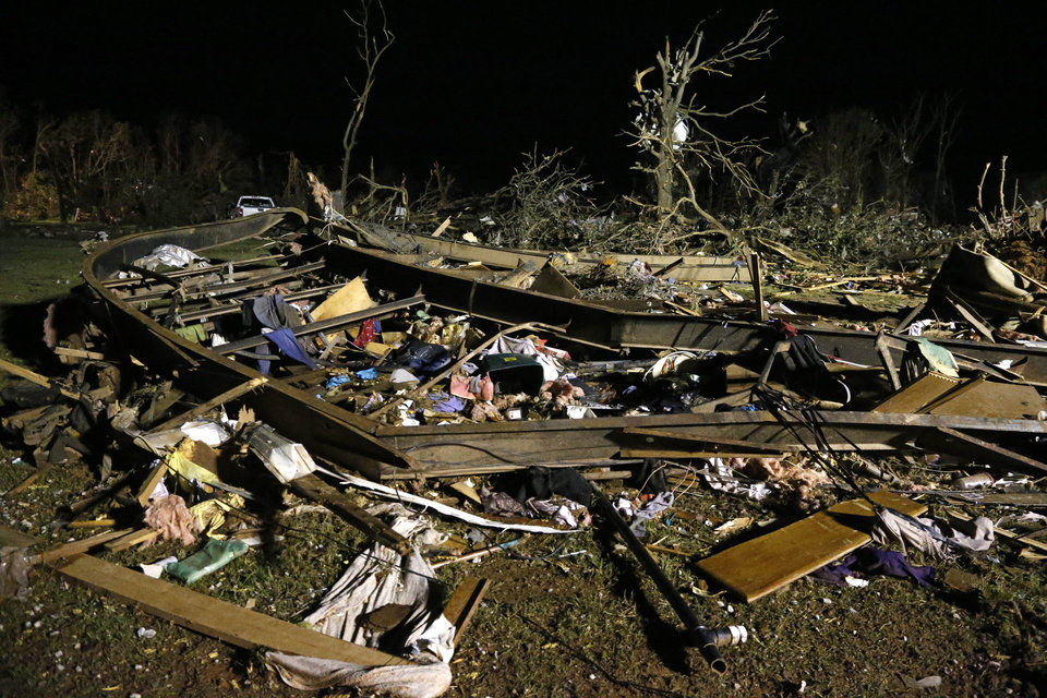 Photo - The frame of a mobile home is pictured with debris after a tornado hit a mobile home park near Dale, Okla., Sunday, May 19, 2013. (AP Photo Sue Ogrocki)