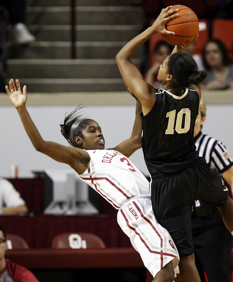 OU's Aaryn Ellenberg (3) takes a charge from Vanderbilt's Christina Foggie (10) in the first half during a women's college basketball game between the University of Oklahoma Sooners and the Vanderbilt Commodores at Lloyd Noble Center in Norman, Okla., Sunday, Dec. 16, 2012. Photo by Nate Billings, The Oklahoman