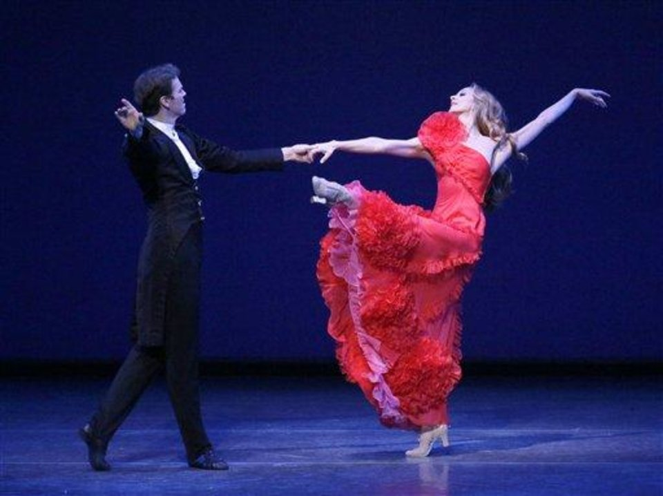 Photo - This Thursday, Sept. 20, 2012 image released by the New York City Ballet shows Maria Kowroski and Charles Askegard in