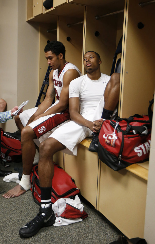 Photo - Stanford's Wade Morgan, right, and Josh Huestis sit in the locker room after a regional semifinal game against Dayton at the NCAA college basketball tournament, Thursday, March 27, 2014, in Memphis, Tenn. Dayton won 82-72. (AP Photo/Mark Humphrey)
