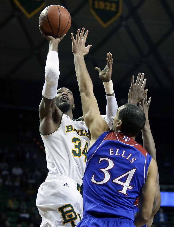 Photo - Baylor forward Cory Jefferson (34) goes up for a shot as Kansas' Perry Ellis (34) defends in the second half of an NCAA college basketball game, Tuesday, Feb. 4, 2014, in Waco, Texas. Jefferson lead his team in scoring with 14-points in the 69-52 loss to Kansas. (AP Photo/Tony Gutierrez)