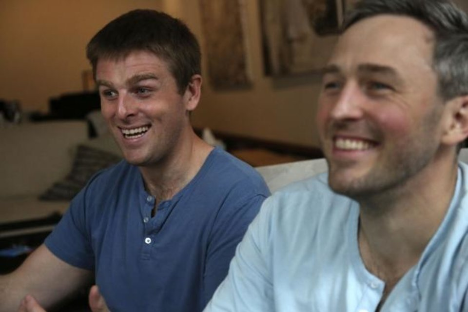 Photo -  Brothers, Bryan, left, and Bradford Manning, laugh as they tell the origin story of their clothing company, Two Blind Brothers. [AP Photo/Jessie Wardarski]