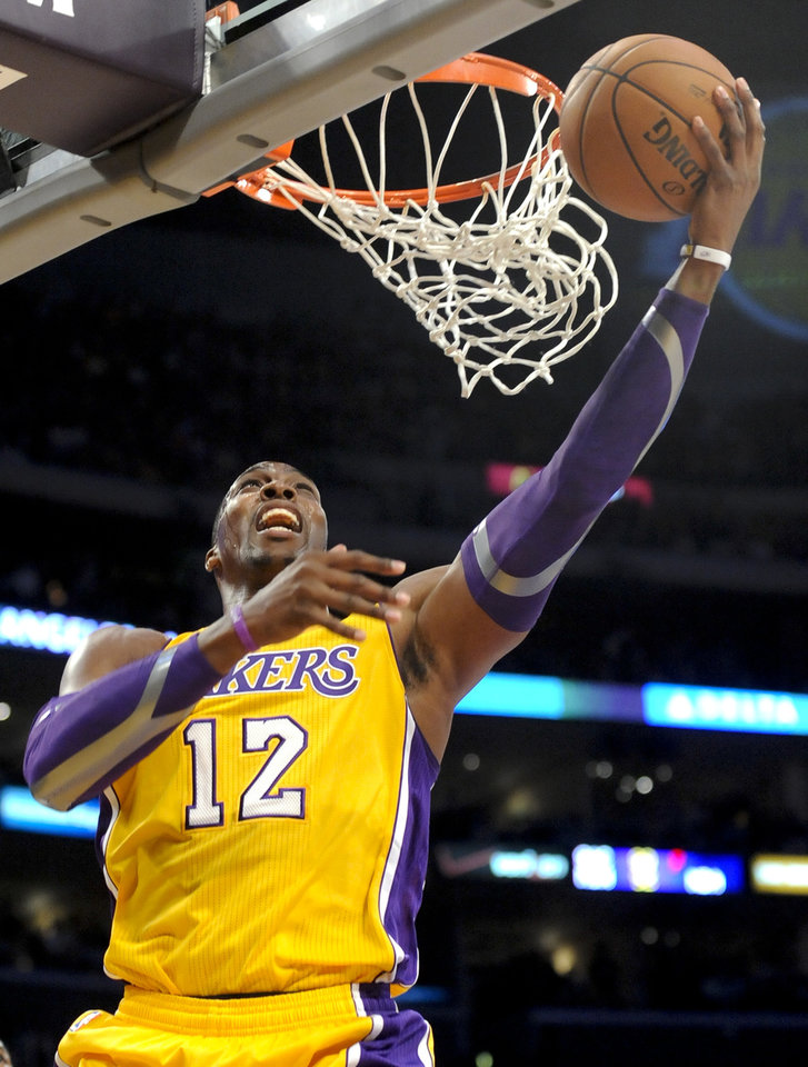 Los Angeles Lakers center Dwight Howard makes a basket in the first half of an NBA basketball game against the Los Angeles Clippers, Friday, Nov. 2, 2012, in Los Angeles.(AP Photo/Gus Ruelas)