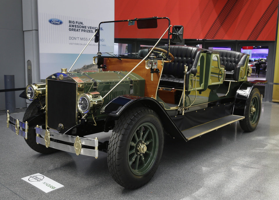 Photo - A prototype of an electric carriage is displayed at the New York International Auto Show in New York, Thursday, April 17, 2014.  A prototype of the old-timey electric cars that Mayor Bill de Blasio would like to take the place of horse-drawn carriages on New York City streets will be unveiled at the New York Auto Show on Thursday. (AP Photo/Seth Wenig)