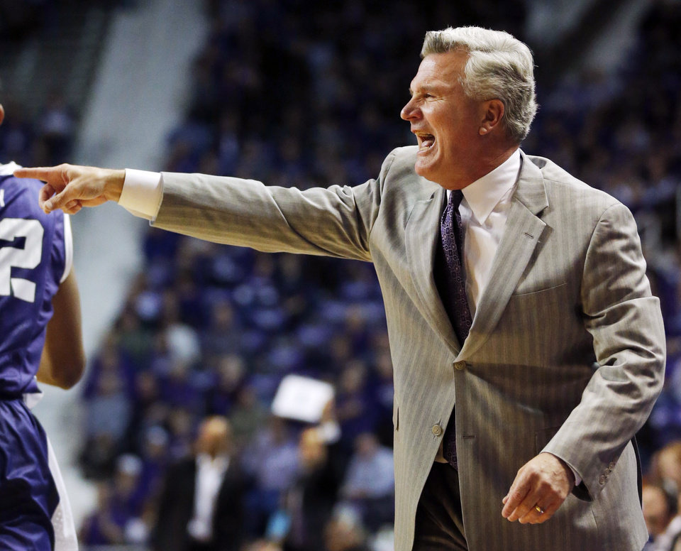 Photo - Kansas State head coach Bruce Weber directs his team during the first half of an NCAA college basketball game against TCU in Manhattan, Kan., Wednesday, Feb. 19, 2014. (AP Photo/Orlin Wagner)