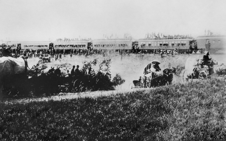 "LAND RUN / HORSES / WAGONS / TRAINS / RAILROADS / CHEROKEE OUTLET / CHEROKEE STRIP:  Caption reads, ""History of Oklahoma--Opening Cherokee Strip.  R.I.[Rock Island] Railroad.""  Undated original.  Photographer unknown.  Unpublished."