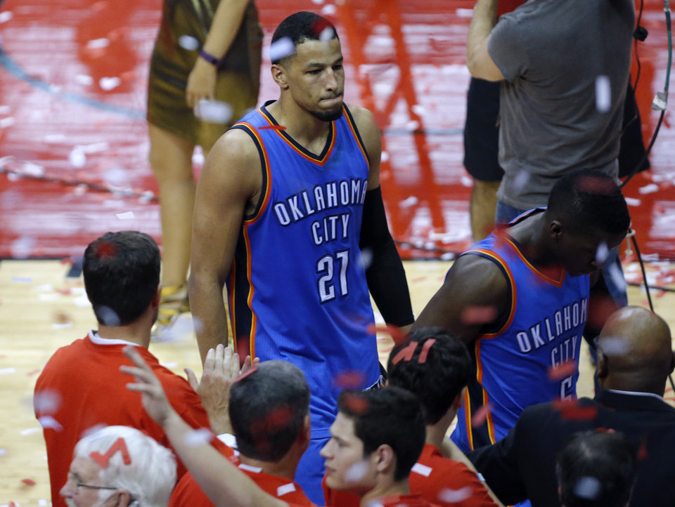 Photo - Oklahoma City's Andre Roberson (21) and Oklahoma City's Victor Oladipo (5) walk off the court following a loss to Houston in the Game 5 in the first round of the NBA playoffs between the Oklahoma City Thunder and the Houston Rockets in Houston, Texas,  Tuesday, April 25, 2017.  Photo by Sarah Phipps, The Oklahoman
