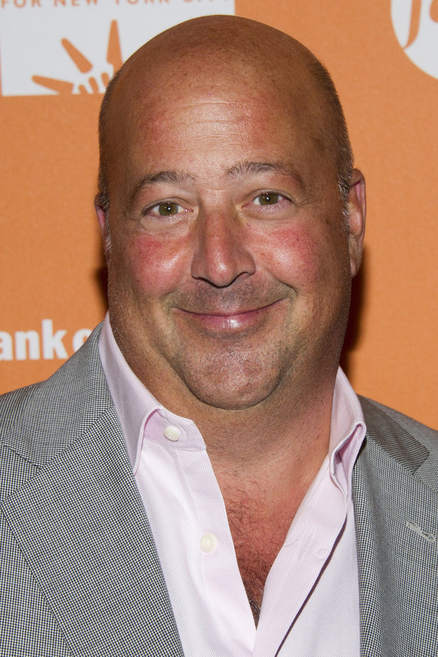 "FILE - In this Oct. 11, 2012 file photo, Andrew Zimmern attends ""On The Chopping Block: A Roast of Anthony Bourdain""  in New York. The James Beard Foundation honored winners in media and publishing in New York on Friday, May 3, 2013, including Zimmern of Travel Channel's �Bizarre Foods America.� He was named outstanding host. (Photo by Charles Sykes/Invision/AP Images, File)"