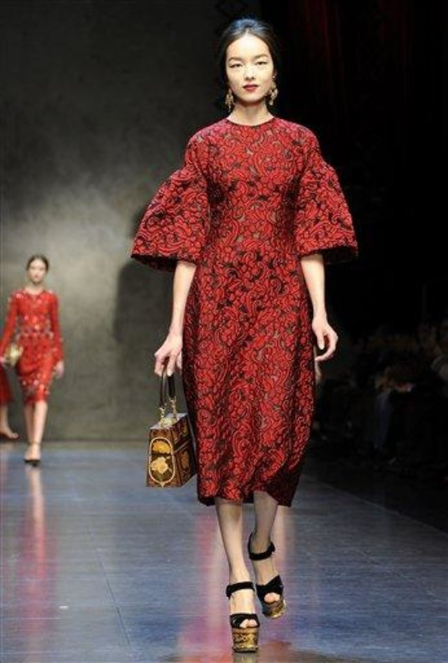 A model wears a creation for Dolce & Gabbana women\'s Fall-Winter 2013-14 collection, part of the Milan Fashion Week, unveiled in Milan, Italy, Sunday, Feb. 24, 2013. (AP Photo/Giuseppe Aresu)