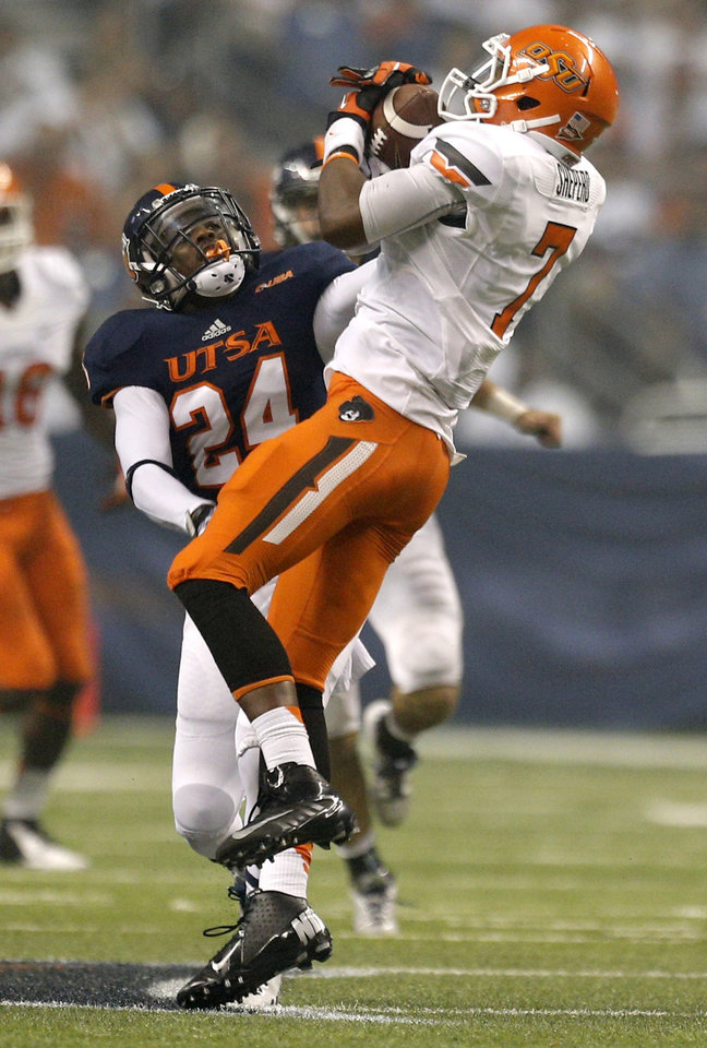 Oklahoma State's Brandon Sheperd (7) makes a catch in front of UTSA's Darrien Starling during the second half of a college football game between the University of Texas at San Antonio Roadrunners (UTSA) and the Oklahoma State University Cowboys (OSU) at the Alamodome in San Antonio, Saturday, Sept. 7, 2013.  Photo by Sarah Phipps, The Oklahoman