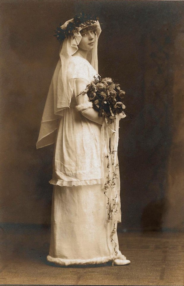 Photo - WEDDING DRESS: Marie Nyquist Hult came from Sweden to America at a young age. While her dress had a more flowing silhouette, a style introduced in the 1910s, the Swedish styles were prominent. The gown was trimmed with white fur and the veil trimmed with typical Swedish style foliage, said Beverly Lee, Hult's daughter. Photo provided by Beverly Lee.