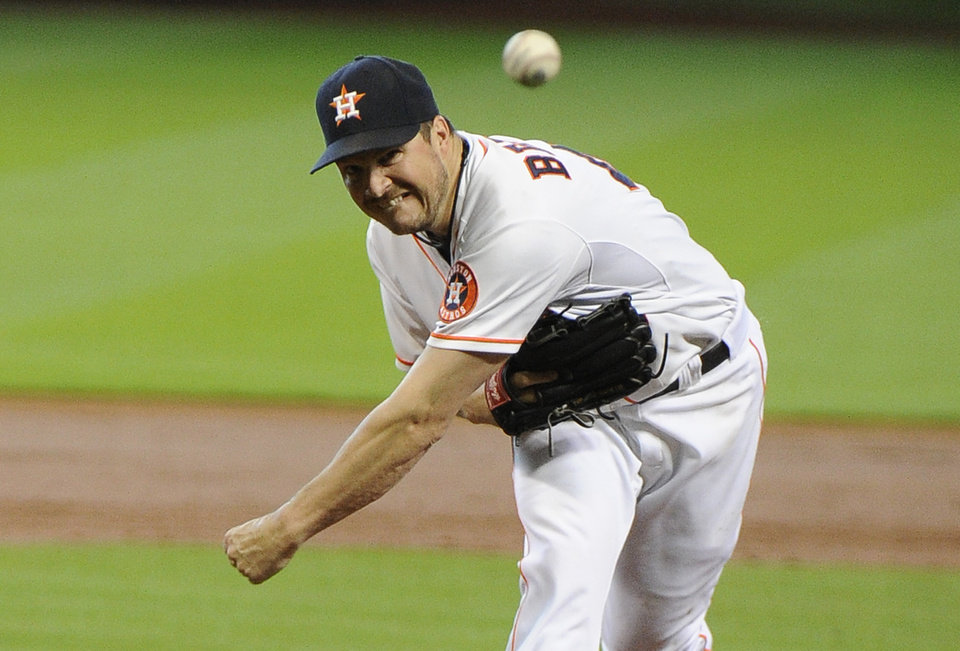 Photo - Houston Astros' Erik Bedard delivers a pitch against the New York Yankees in the second inning of a baseball game Sunday, Sept. 29, 2013, in Houston. (AP Photo/Pat Sullivan)