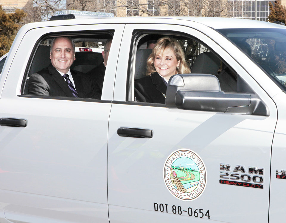 Peter Grady, vice president of Network Development and Fleet-Chrysler Group LLC and Gov. Mary Fallin take a ride Wednesday in a CNG pickup purchased by the state for use by Oklahoma Department of Transportation. Photo By David McDaniel, The Oklahoman