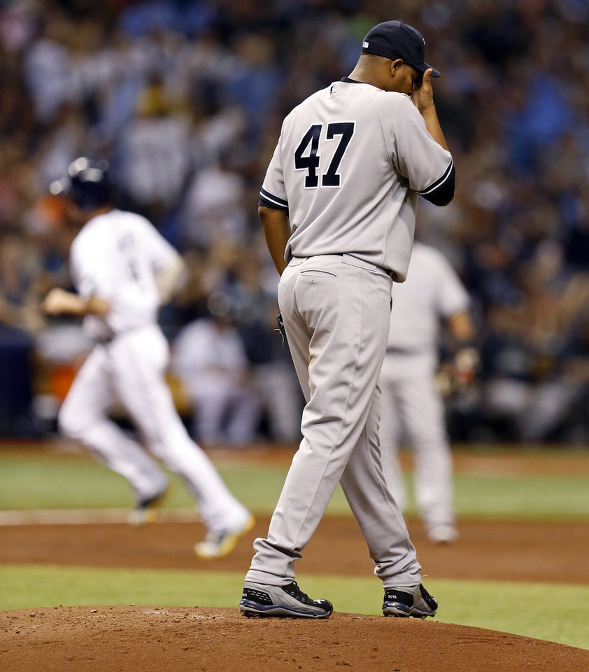 Photo - New York Yankees starting pitcher Ivan Nova reacts after giving up a home run to Tampa Bay Rays' Wil Myers during the second inning of a baseball game, Saturday, April 19, 2014, in St. Petersburg, Fla. (AP Photo/Mike Carlson)