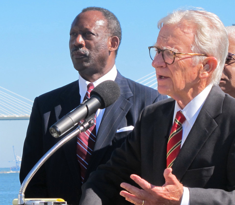 Photo - Wilbur Johnson, left, the chairman of the board of the International African American Museum, listens as Charleston Mayor Joseph P. Riley Jr., announces updated plans for the museum during a news conference on the waterfront in Charleston, S.C., on Wednesday, Oct. 23, 2013. Riley said the $75 million museum will be financed with a combination of city, county and state funds as well as private donations. Construction is expected to begin in about two years. (AP Photo/Bruce Smith)