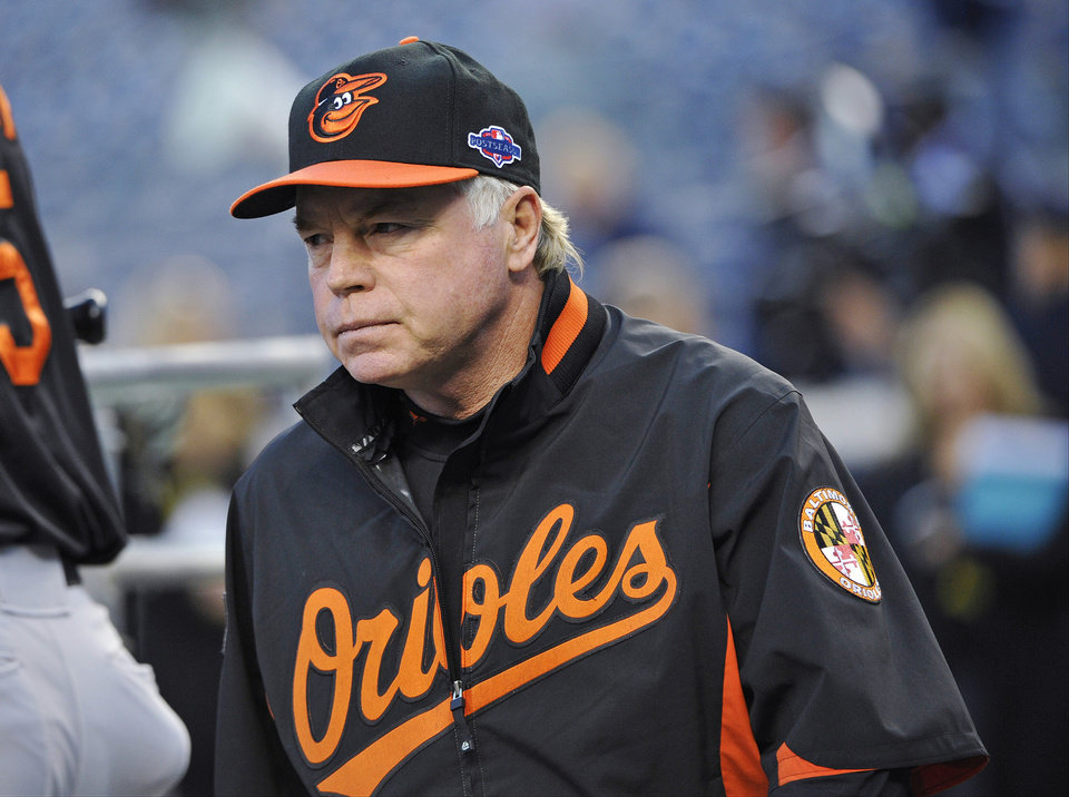 Baltimore Orioles manager Buck Showalter walks in the dugout before Game 3 of the Orioles\' American League division baseball series against the New York Yankees Wednesday, Oct. 10, 2012, in New York. (AP Photo/Bill Kostroun)