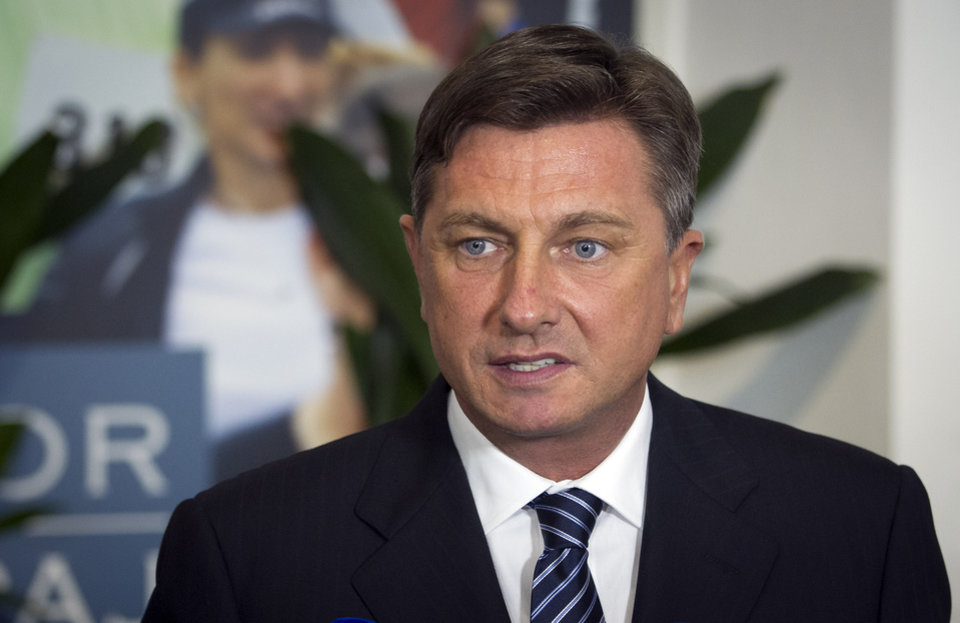 Photo - Slovenia's former prime minister Borut Pahor talks to the media at his headquarters in Ljubljkana, Slovenia, Sunday, Dec. 2, 2012. An exit poll published by Slovenia's state television has shown that former prime minister Borut Pahor has won the presidential election in the crisis-hit EU country with 67.3 percent of the vote.  (AP Photo/Darko Bandic)