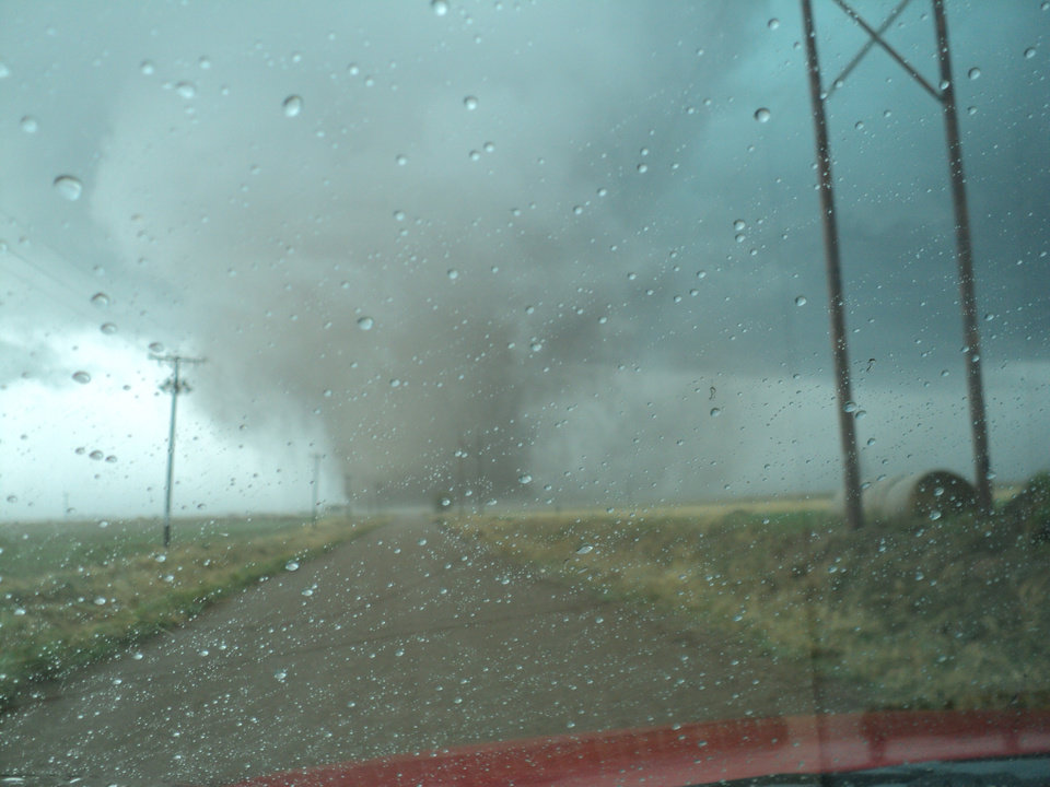 A tornado is seen Monday afternoon sweeping across Tillman County. Several buildings were damaged by the tornado. PHOTO PROVIDED BY RANDY HASLEY, FOR THE OKLAHOMAN