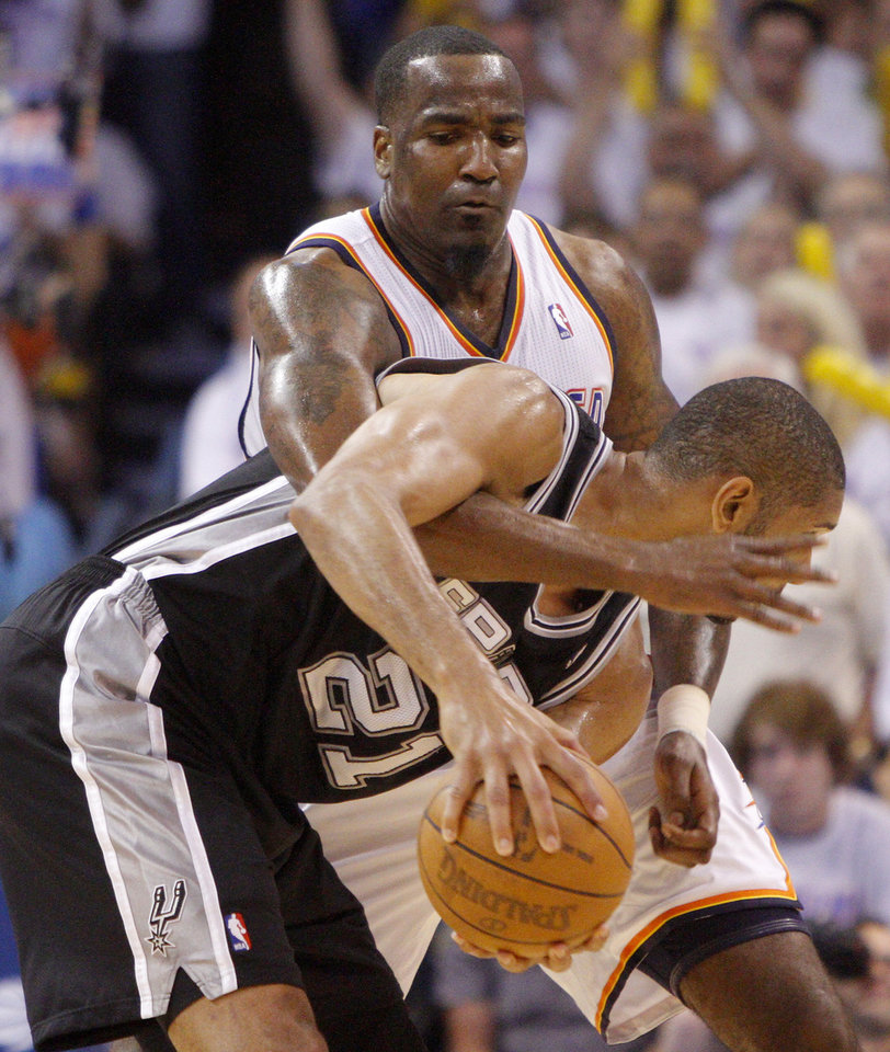 Photo - Oklahoma City's Kendrick Perkins (5) defends San Antonio's Tim Duncan (21) during Game 6 of the Western Conference Finals between the Oklahoma City Thunder and the San Antonio Spurs in the NBA playoffs at the Chesapeake Energy Arena in Oklahoma City, Wednesday, June 6, 2012. Oklahoma City won 107-99. Photo by Bryan Terry, The Oklahoman