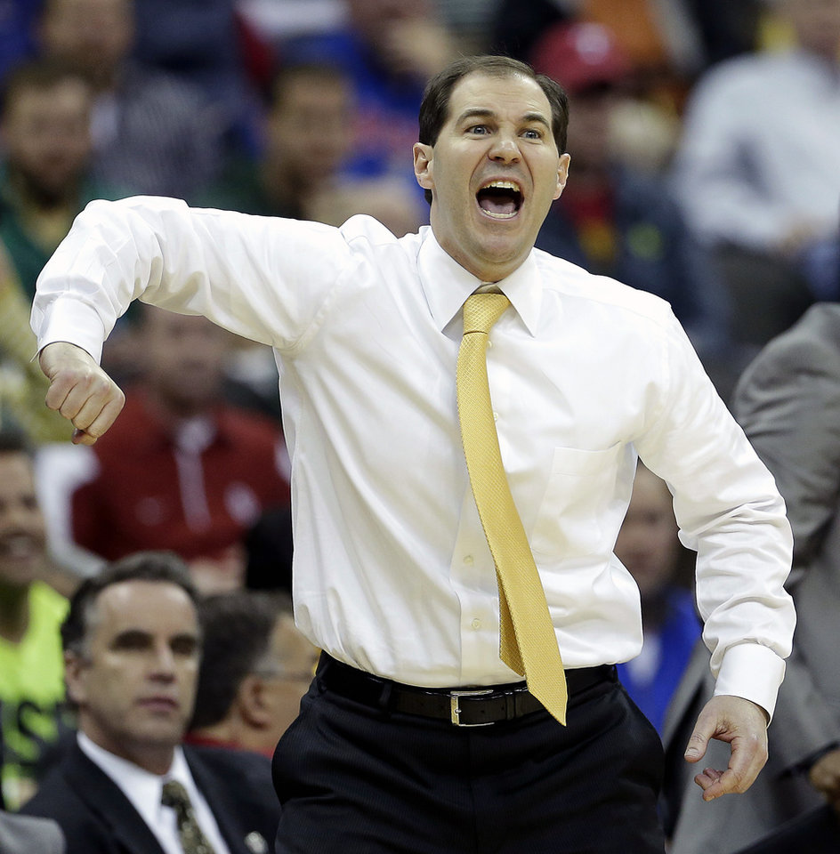 Photo - Baylor coach Scott Drew encourages his team during the second half of an NCAA college basketball game against Oklahoma in the Big 12 men's tournament on Thursday, March 13, 2014, in Kansas City, Mo. Baylor won the game 78-73. (AP Photo/Charlie Riedel)