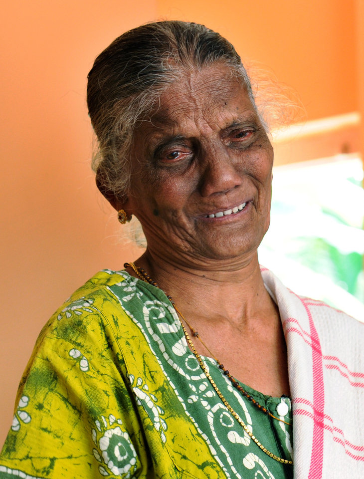 Photo - In this Saturday, Dec. 8, 2012 photo, Carmine Barboza, Mother-in-law of nurse at King Edward VII hospital, London, Jacintha Saldanha, breaks down as she speaks to the media after knowing about Saldanha's death in central London, at their village house in Shirva north of Mangalore, India. Australian radio hosts managed to impersonate Queen Elizabeth II and Prince Charles and received confidential information about the Duchess of Cambridge's medical condition, in a hoax phone call to the King Edward VII hospital where the pregnant Duchess was staying and which was broadcast on-air. The controversial prank took a dark twist three days later with the death of nurse Saldanha, a 46-year-old mother of two, who was duped by the DJs despite their Australian accents. (AP Photo)