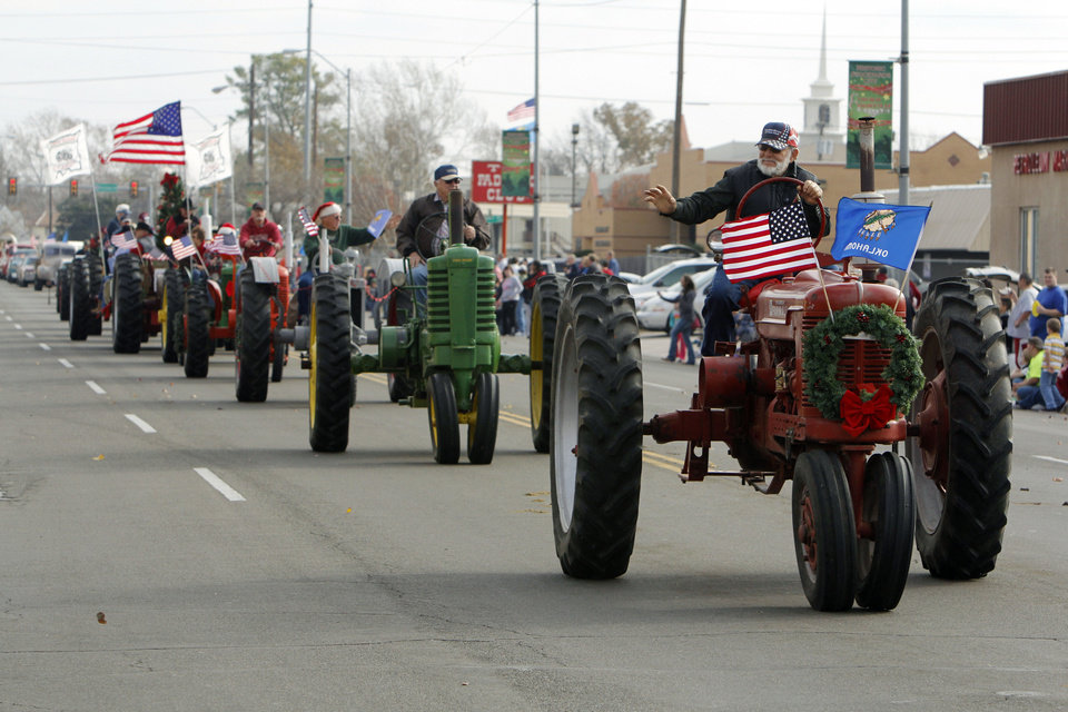 Antique tractors ride in the Stockyards City Christmas parade in Oklahoma City, OK, Saturday, December 1, 2012,  By Paul Hellstern, The Oklahoman