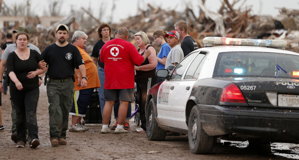 Emergency personal talk with people outside Plaza Towers Elementary School in Moore, Okla., after a tornado destroyed the neighborhood on Monday, May 20, 2013. Photo by Bryan Terry, The Oklahoman