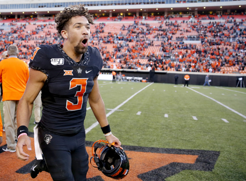 Photo - Oklahoma State's Spencer Sanders (3) celebrates following the college football game between the Oklahoma State University Cowboys and the TCU Horned Frogs at Boone Pickens Stadium in Stillwater, Okla.,  Saturday, Nov. 2, 2019. [Sarah Phipps/The Oklahoman]