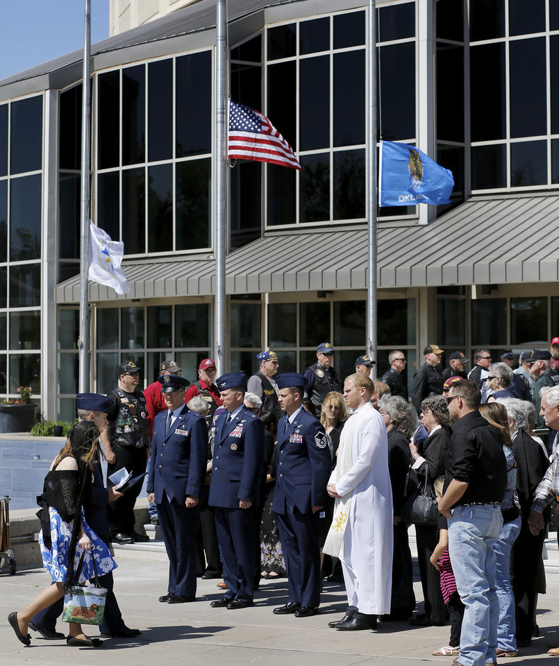 The widow of SSgt. Daniel Fannin is escorted back to the building after her late husband's casket was placed inside a hearse following the service for him. More than 1,700 people, many of whom were dressed in the US Air Force's  dark blue service dress uniform, filled the lower and upper levels of the Rose State College Performing Arts Center Monday morning, May, 13, 2013, to attend a memorial service for SSgt. Daniel N. Fannin, a brother in arms killed April 27 in a plane crash while on a mission in Afghanistan.  Fannin , 30, was assigned to the 552nd Operations Support Squadron at Tinker Air Force base. He joined the Air Force in 2001. Photo  by Jim Beckel, The Oklahoman.