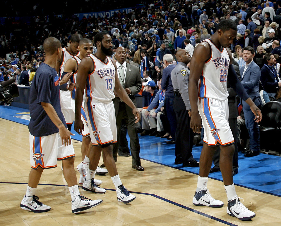 Photo - The Thunder walk off the court following a loss to Miami during the NBA basketball game between Oklahoma City and Miami at the OKC Arena in Oklahoma City, Thursday, Jan. 30, 2011. Photo by Sarah Phipps, The Oklahoman