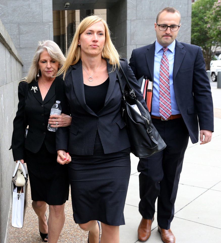 Photo - Former Virginia First Lady Maureen McDonnell, left, and two of her lawyers, Heather Martin, center, and Stephen Michael Hauss, right, leave the Federal Courthouse in Richmond, Va., Tuesday, July 29, 2014. McDonnell and her husband, former Gov. Bob McDonnell, are charged in a 14-count indictment with accepting more than $165,000 in loans, designer clothes, vacations and a Rolex watch from Jonnie Williams, the CEO of dietary supplements maker Star Scientific. (AP Photo/Richmond Times-Dispatch, Bob Brown)