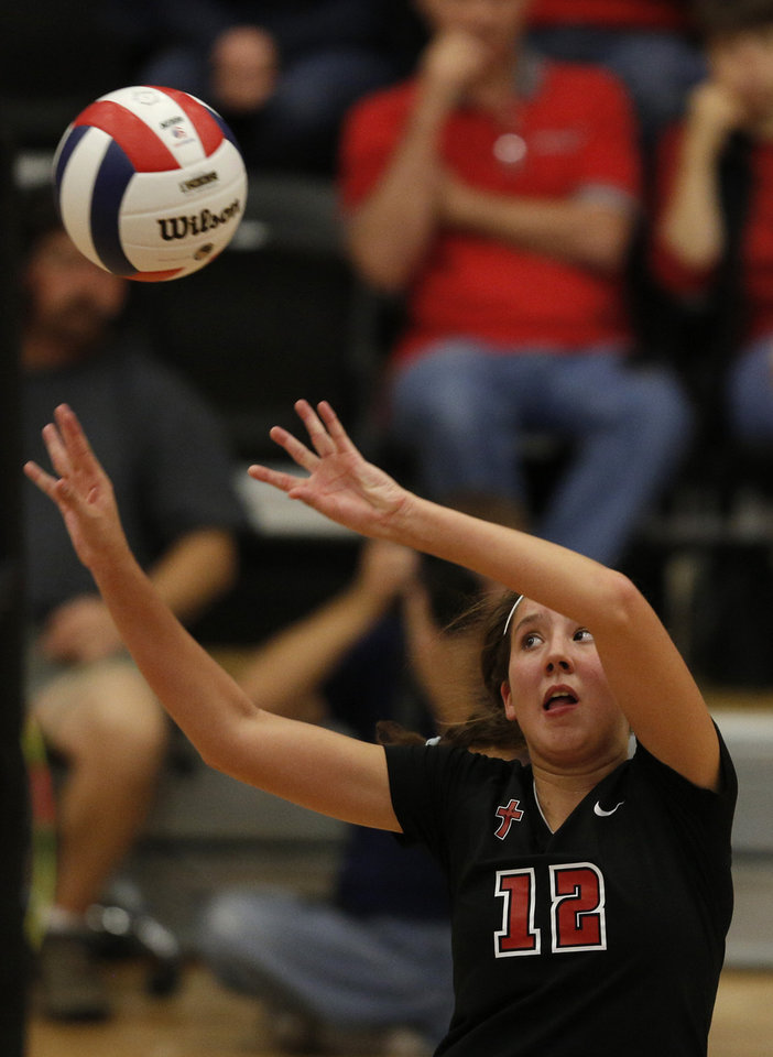 Bishop Kelley's Claire Kelley (12) hits the ball during the OSSAA 6A State Volleyball Championship between Bishop Kelley and Edmond Memorial at Westmoore High School in Moore, Okla., Saturday, Oct. 13, 2012.  Photo by Garett Fisbeck, The Oklahoman