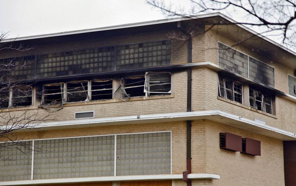 Photo - The old John Marshall High School building on Monday, Dec. 31, 2012, in Oklahoma City, Okla. A fire that destroyed four classrooms in the building was determined to be intentionally set. The building is in the process of being sold and is scheduled for demolition   Photo by Chris Landsberger, The Oklahoman