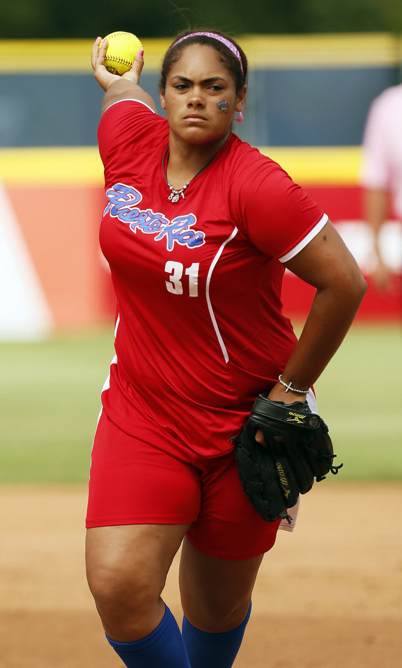 Lissette Garay (31) pitches for Puerto Rico during a game in the World Cup of Softball between the USA and Puerto Rico at ASA Hall of Fame Stadium in Oklahoma City, Sunday, July 14, 2013. Team USA won, 10-3 in five innings. Photo by Nate Billings, The Oklahoman