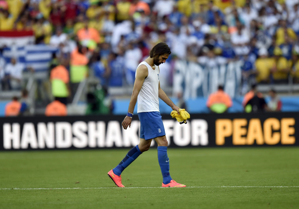 Photo - Greece's Giorgos Samaras walks off the field after his team's 3-0 loss to Colombia during the group C World Cup soccer match between Colombia and Greece at the Mineirao Stadium in Belo Horizonte, Brazil, Saturday, June 14, 2014.  (AP Photo/Martin Meissner)
