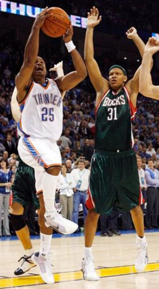 Photo -  Earl Watson (25) of the Thunder scores the first basket past Charlie Villanueva (31) of the Bucks during the NBA basketball game between the Oklahoma City Thunder and the Milwaukee Bucks at the Ford Center in Oklahoma City, Wednesday, Oct. 29, 2008. This was the regular season debut of the Thunder. BY NATE BILLINGS, THE OKLAHOMAN