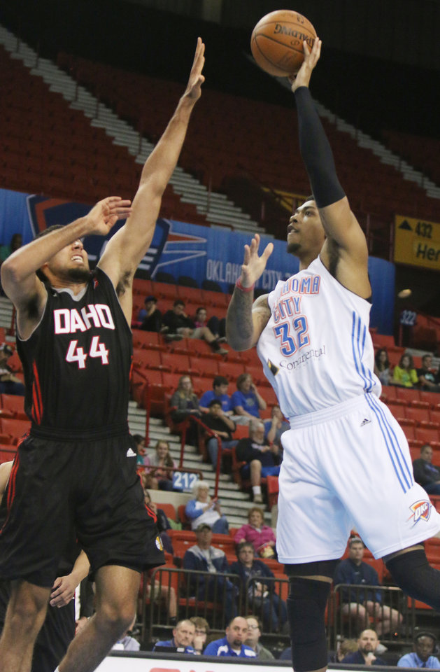 Photo - OKC's Richard Solomon, 32, shoots against Idaho's Grant Jerrett, 44, during the D-League game between the Oklahoma City Blue and the Idaho Stampede on Friday, April 3rd and the Cox Convention Center in Oklahoma City. Photo by Alyssa Ramsey, The Oklahoman