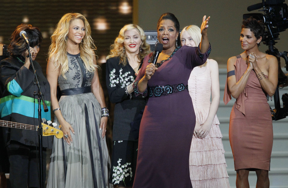 Photo -   FILE - In this May 17, 2011 file photo, Oprah Winfrey gestures as she is surrounded by, from left, Patti LaBelle, Beyoncé, Madonna, Dakota Fanning and Halle Berry during a star-studded double-taping of